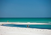 Vacationers on the beach at the shoreline of Anna Maria Island, Florida, United States of America