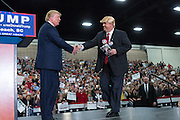 Republican presidential candidate billionaire Donald Trump meets a look-a-like during a campaign rally at the Myrtle Beach Convention Center November 24, 2015 in Myrtle Beach, South Carolina.