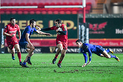 Scarlets' Paul Asquith evades the tackle of Leinster's Ross Byrne<br /> <br /> Photographer Craig Thomas/Replay Images<br /> <br /> Guinness PRO14 Round 17 - Scarlets v Leinster - Friday 9th March 2018 - Parc Y Scarlets - Llanelli<br /> <br /> World Copyright © Replay Images . All rights reserved. info@replayimages.co.uk - http://replayimages.co.uk