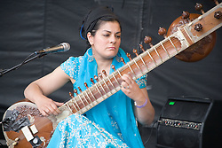 Sheema Mukherjee  playing a sitar on stage at the WOMAD (World of Music; Arts and Dance) Festival in reading; 2005,