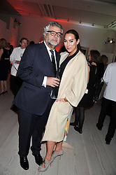 ALEX MEYERS and her husband at a party hosted by Ines de la Frassange and Bruno Frisoni for Roger Vivier to launch the Roger Vivier book held at The Saatchi Gallery, London on 24th April 2013.