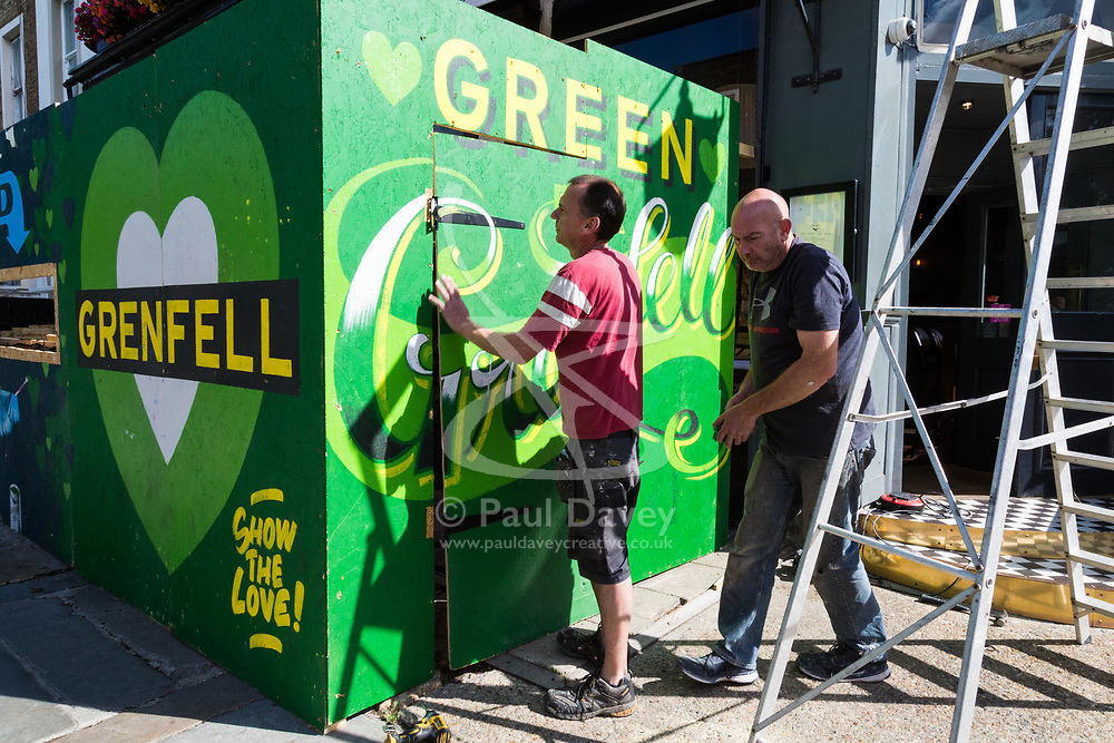Workmen at The Eagle pub on Ladbroke Grove erect hoardings as shops and properties in the west London area of the Notting Hill Carnival prepare for the hundreds of thousands of revellers by erecting protective hoardings. London, August 24 2018.