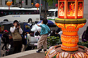 """Vater fotografiert seinen Sohn vor dem Eingang zu einem Tempel waehrend der Feierlichkeiten von Buddhas Geburtstag (2. Mai 2009) im Zentrum der koreanischen Netropole Seoul.<br /> <br /> Father photographing his son infront of the entrance to a temple in the center of the korean capital Seoul during the celebrations of Buddhas birthday (2nd of May 2009) which is celebrated according to the Lunisolar calendar. This day is called """"Seokga tansinil"""", meaning """"the day of Buddha's birthday""""."""