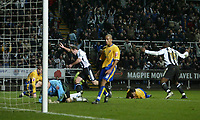 Photo: Andrew Unwin.<br />Newcastle United v Mansfield Town. The FA Cup.<br />07/01/2006.<br />Newcastle's Alan Shearer (C) wheels away after scoring his 200th club goal.
