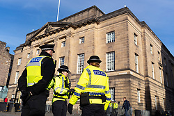 Police stand outside the High Court of Justiciary on the Royal Mile in Edinburgh, Scotland, UK
