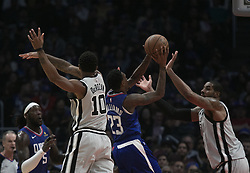 November 15, 2018 - Los Angeles, California, U.S - Lou Williams #23 of the Los Angeles Clippers tries to pass between two defenders during their NBA game with the San Antonio Spurs on Thursday November 15, 2018 at the Staples Center in Los Angeles, California. (Credit Image: © Prensa Internacional via ZUMA Wire)