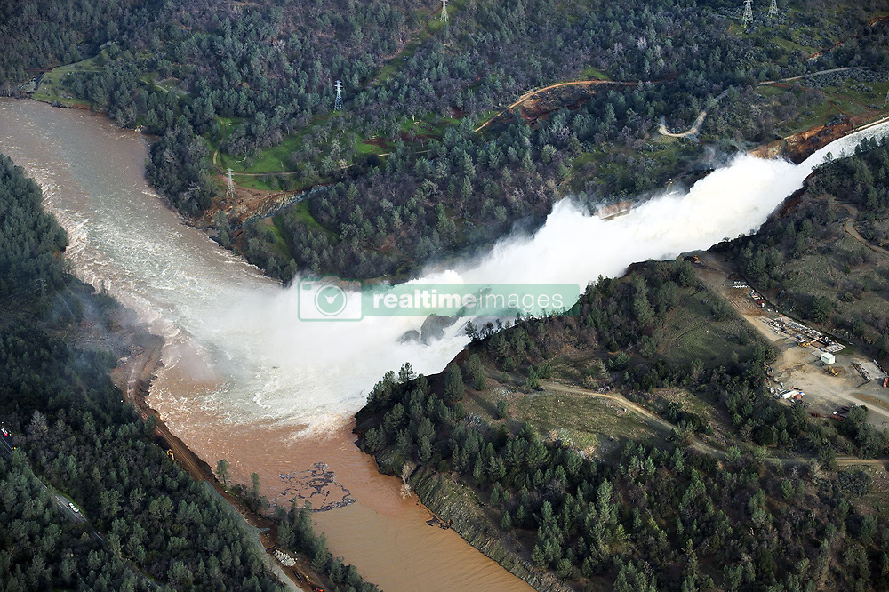 February 13, 2017 - Rancho Cordova, California, U.S. - An aerial photo shows the heavy flow of water down the Oroville Dam main spillway on Monday. Approximately 100,000 cfs were released. (Credit Image: © Randy Pench/Sacramento Bee via ZUMA Wire)