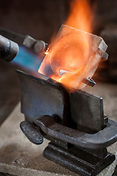 Melting copper in a jewelry shop, Bavaria, Germany