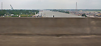 Atchafalaya River obstructed view from US 90 showing an insustrial area at Amelia, Louisiana panorama