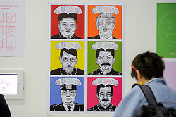 """© Licensed to London News Pictures. 11/05/2017. London, UK. A visitor views a work, featuring current and past political figures, by Yasmin Saito Alkuwari at an exhibition called """"Up and Coming"""", in Granary Square King's Cross.  The exhibition includes works by Central Saint Martins foundation students.   Photo credit : Stephen Chung/LNP"""
