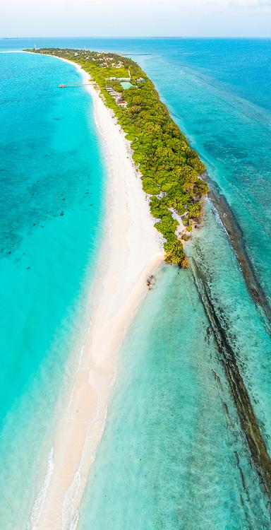 Vertical panoramic aerial view of Vashafaru island with sandbank, Maldives, Laccadive Sea.