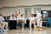An inmate works with Lordy on a small Rally-O course after it was first introduced to the men and dogs at Coyote Ridge Corrections Center.  Pet photos by Michael Kloth.