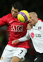 Photo: Paul Thomas/Sportsbeat Images.<br /> Manchester United v Fulham. The FA Barclays Premiership. 03/12/2007.<br /> <br /> Cristiano Ronaldo (L) of Utd battles with Paul Konchesky.