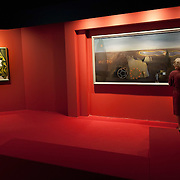 """MILAN, ITALY - SEPTEMBER 21:  A woman admires """"The Search for the fourth dimension"""", oil painting by Salvador Dali at the Exhibition preview at Palazzo Reale on September 21, 2010 in Milan, Italy. Dali is back in Milan with Il sogno si avvicina, an exhibition that takes place at Palazzo Reale  and that focus on the relationship between the great Spanish artist's visions and his favourite themes:  landscape, dream and desire."""