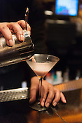 Barman preparing cocktails at the Club Privé inside the Bellagio Hotel in Las Vegas, Nevada