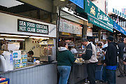San Francisco California USA, California city downtown tourists at a fish stall near pier 39 Fishermen's Wharf