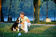 Kimberly Winsor of Alexandria VA enjoys an early morning walk with her dog Lilly in Washington D.C.'s National Mall.