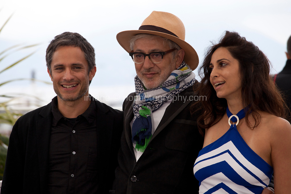 Gael García Bernal,Elia Suleiman and Yasmine Hamdan  at It Must Be Heaven film photo call at the 72nd Cannes Film Festival, Friday 24th May 2019, Cannes, France. Photo credit: Doreen Kennedy