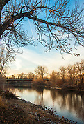 The rays of the late afternoon sun illuminate the Boise River downstream from Barber Park
