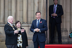 © Licensed to London News Pictures . 23/10/2015 . Manchester , UK . British Prime Minister DAVID CAMERON (2nd from r) waiting for Chinese president , Xi Jinping with Lord Mayor of Manchester Cllr PAUL MURPHY (l), outside Manchester Town Hall during a Chinese state visit to Manchester as part of his state visit to the United Kingdom . Photo credit: Joel Goodman/LNP