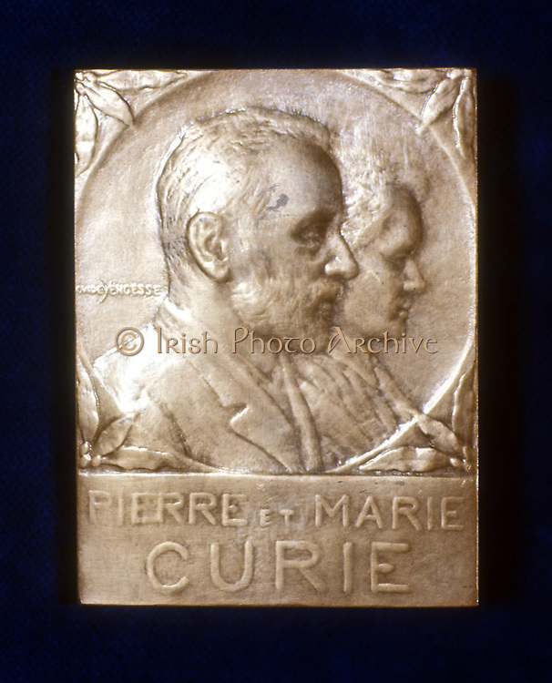 Marie (1867-1934) and Pierre (1859-1906) Curie. From a commemorative plaquette. In 1903 the Curies shared the Nobel prize for physics with Henri Becquerel for work on radioactivity