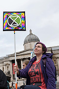 A female Extinction Rebellion protester at Trafalgar Square on the 7th October 2019 in Central London in the United Kingdom. Extinction Rebellion protesters occupy locations across central London including Westminster Bridge, Whitehall and Trafalgar Square in a wave of protests planned to continue for 2 weeks.