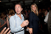 SAM DOWLER; CHLOE MADELEY, South Pacific First night party. The Barbican. London. 23 August 2011. <br /> <br />  , -DO NOT ARCHIVE-© Copyright Photograph by Dafydd Jones. 248 Clapham Rd. London SW9 0PZ. Tel 0207 820 0771. www.dafjones.com.