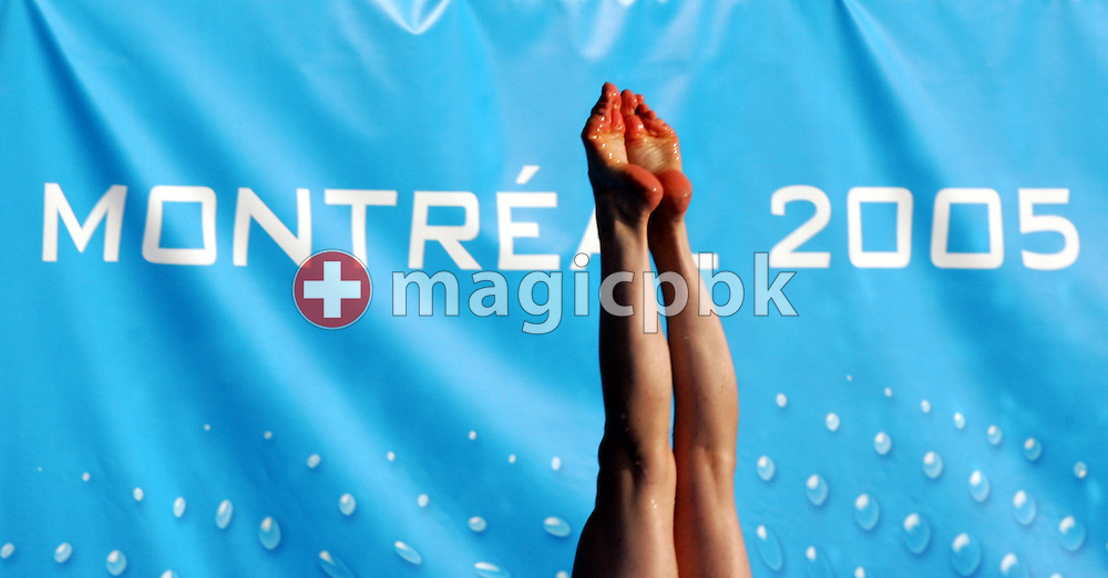 A diver passes a Montreal sign as she practices during the final warm-up day before the start of competition at the FINA World Championships in Montreal, Quebec Saturday 16 July, 2005. The Championships run from July 17 through July 31 featuring the World Championships of Swimming, Diving, Water Polo, Synchronized Swimming and Open Water Swimming. (Photo by Patrick B. Kraemer / MAGICPBK)