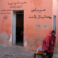 North Africa, Africa, Morocco, Marrakesh. Scene of daily life on a street corner in Marrakesh.