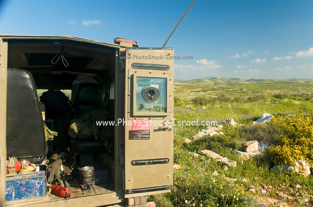 Israel, West Bank, Israeli reserve soldiers on patrol during active duty. Exterior of the armoured jeep
