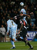 Photo: Steve Bond/Sportsbeat Images.<br />Coventry City v West Bromwich Albion. Coca Cola Championship. 12/11/2007. Dele Adebola rises highest