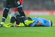Uruguay midfielder Lucas Torreira (14) lays on the ground after a tackle during the Friendly International match between Brazil and Uruguay at the Emirates Stadium, London, England on 16 November 2018.