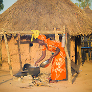 A Koumbadiouma woman prepares a special meal of meat (rare in these hard times) for Tamkharit, the Senegalese name for Islamic New Year. Kolda, Senegal.