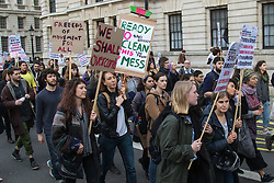 London, February 20th 2017. Anti-Trump and anti-Brexit protesters march on Parliament Square as the Commons debates the proposed state visit of US President Donald Trump following a 1,8million-strong petition against his visit. PICTURED: Students from SAOS and King's College march towards Parliament Square.