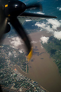 Propellers of an aircraft flying over Vinh Long city and the Mekong River, Vietnam, Southeast Asia