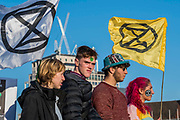 Westminster Bridge is still blocked - Extinction Rebellion Day -  co hosted by Rising Up, 'Rebel Against the British Government For Criminal Inaction in the Face of Climate Change Catastrophe and Ecological Collapse'. A protest that involves blocking 5 bridges: Southwark, Blackfriars, Waterloo, Westminster and Lambeth.