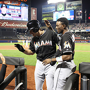 J.T. Realmuto, MIami Marlins, is congratulated by Dee Gordon, after hitting a home run during the New York Mets Vs Miami Marlins MLB regular season baseball game at Citi Field, Queens, New York. USA. 16th September 2015. Photo Tim Clayton
