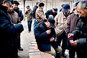 Men playing cards on the streets in Beijing, China, on friday 18. jan, 2008