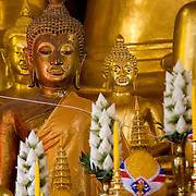 Golden buddha statues on buddhist temple altar (Chiang Mai, Thailand - Dec. 2008) (Image ID: 081204-1250081a)
