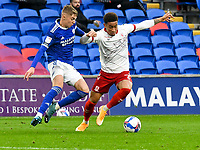 Football - 2020 / 2021 Sky Bet Championship - Cardiff City vs Middlesbrough - Cardiff City Stadium<br /> <br /> Marcus Tavernier of Middlesbrough on the attack  Joel Bagan of Cardiff City defends <br /> in a match played without fans<br /> <br /> COLORSPORT