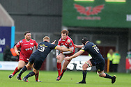 Rhys Patchell of the Scarlets © looks for a way past John Ryan (3) of Munster. Guinness Pro12 rugby match, Scarlets v Munster at the Parc y Scarlets in Llanelli, West Wales on Saturday 3rd September 2016.<br /> pic by  Andrew Orchard, Andrew Orchard sports photography.