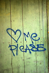Love me please graffiti on wall, Southern France 2021