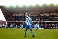 Photo: Scott Heavey.<br />Oxford United v Huddersfeild Town. Nationide Division Three. 06/03/2004.<br />Efe Sodje applauds the travelling Huddersfield fans after scoring the winner