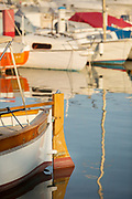Stern with steer of vintage wooden sailing boat on water, Golfe-Juan, France.