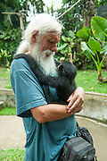 Nursing a very affectionate 8-month old baby Gibbon