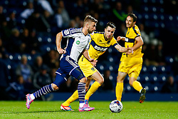 James Morrison of West Brom is challenged by Josh Ruffels of Oxford United - Photo mandatory by-line: Rogan Thomson/JMP - 07966 386802 - 26/08/2014 - SPORT - FOOTBALL - The Hawthorns, West Bromwich - West Bromwich Albion v Oxford United - Capital One Cup Round 2.