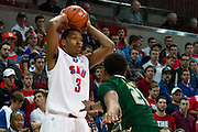 DALLAS, TX - JANUARY 15: Sterling Brown #3 of the SMU Mustangs brings the ball up court against the South Florida Bulls on January 15, 2014 at Moody Coliseum in Dallas, Texas.  (Photo by Cooper Neill/Getty Images) *** Local Caption *** Sterling Brown