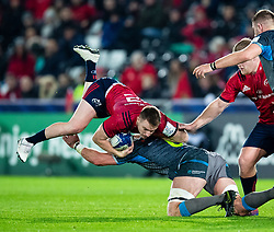 Rory Scannell of Munster  is tackled by Dan Lydiate of Ospreys<br /> <br /> Photographer Simon King/Replay Images<br /> <br /> European Rugby Champions Cup Round 1 - Ospreys v Munster - Saturday 16th November 2019 - Liberty Stadium - Swansea<br /> <br /> World Copyright © Replay Images . All rights reserved. info@replayimages.co.uk - http://replayimages.co.uk