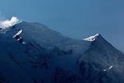 The sun peaks over the mountain tops in the morning above Chamonix, French Alps