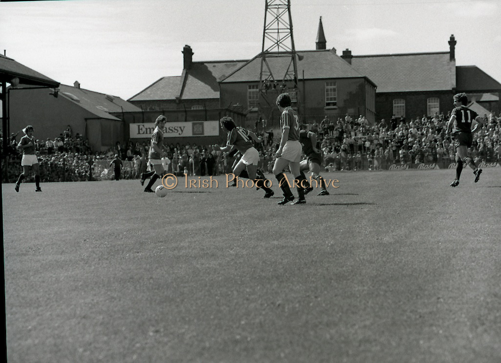 League of Ireland vs Liverpool FC.    (M87)..1979..18.08.1979..08.18.1979..18th August !979..In a pre season friendly the League of Ireland took on Liverpool FC at Dalymount Park Phibsborough,Dublin. The league team was made up of a selection of players from several League of Ireland clubs and was captained by the legendary John Giles. Liverpool won the game by 2 goals to nil..The scorers were Hansen and McDermott...John Giles is pictured taking control of the ball to set up an Irish raid on the Liverpool goal.